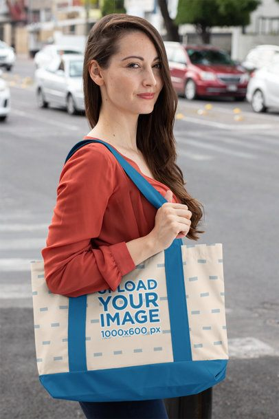 Weekend Tote Bag Mockup Featuring a Long-Haired Woman Standing by a City Street 29792