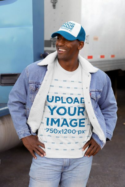 Mockup of a Man Wearing a Customizable T-Shirt and Trucker Hat in the Street 29475
