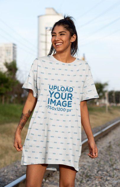 Mockup of a Woman in a Shift Dress Walking in the Railroads 29734