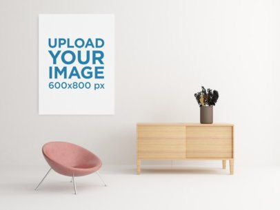 Mockup of an Art Print Hanging by a Minimalist Cabinet and a Modern Chair 337-el