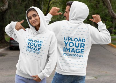 Both-Sides View Mockup of a Couple Pointing at Their Pullover Hoodies 29788