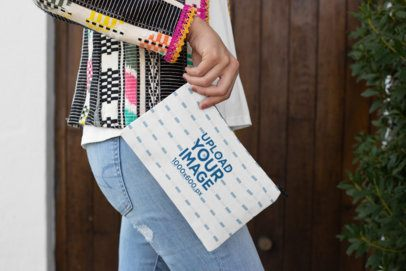 Mockup of a Woman Holding a Sublimated Pouch 29970