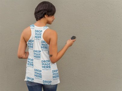 Back of a Girl Wearing a Sublimated Tank Top Mockup Checking her Phone a9240b