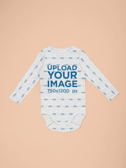 Heathered Mockup of a Long Sleeve Onesie Lying Flat on a Surface 29832