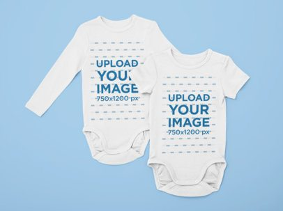 Flat Lay Mockup of Two Onesies on a Solid Surface 29842