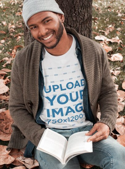 T-Shirt Mockup of a Man Reading in the Woods 30282