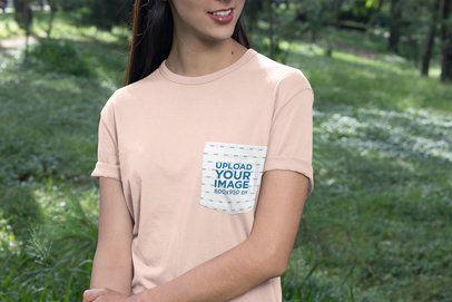 Pocket T-Shirt Mockup Featuring a Woman at a Park 30080