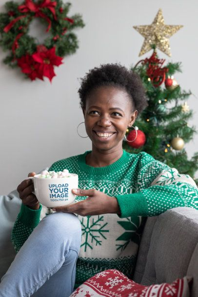 24 oz Mug Mockup Featuring a Woman in a Christmas Decorated Living Room Drinking Cocoa 30347