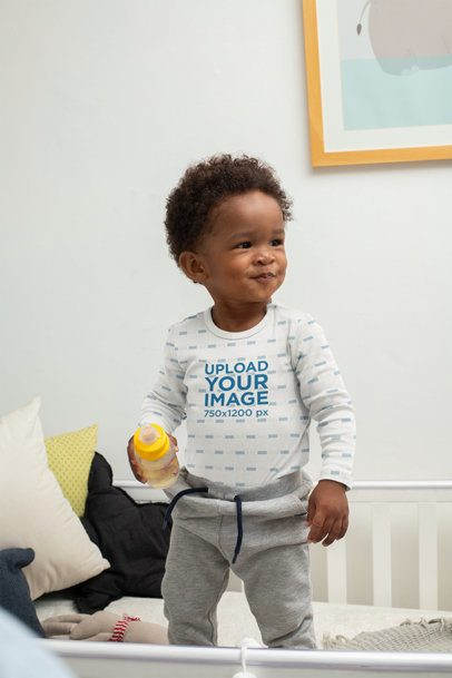 Mockup of a Baby Boy Wearing a Onesie in His Crib 30034