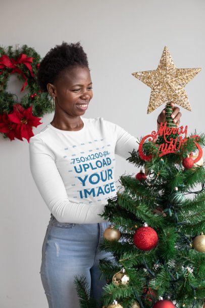 Long Sleeve Tee Mockup of a Happy Woman Placing the Christmas Tree Star 30351