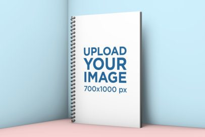 Spiral Notebook Mockup Standing Against a Solid Surface 1006-el