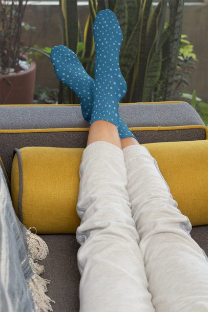 Socks Mockup of a Woman Lying on a Couch with Her Feet Up 29526