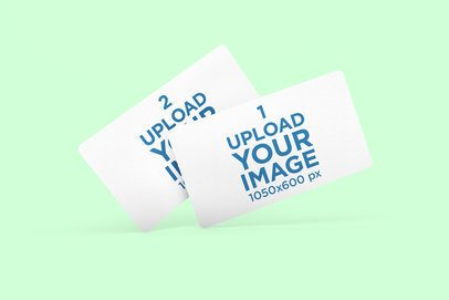 Mockup of Two Business Cards with Rounded Corners Floating Against a Plain Background 978-el