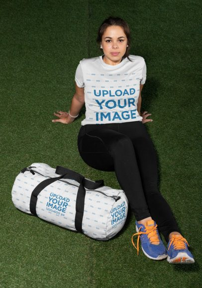 Plus Size T-Shirt Mockup of a Woman Sitting Next to a Duffle Bag 30155