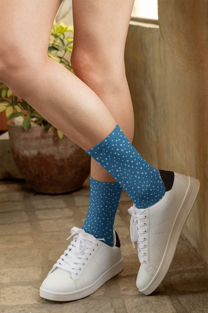 Mockup of a Woman with Crossed Legs Wearing Customizable Socks 29542