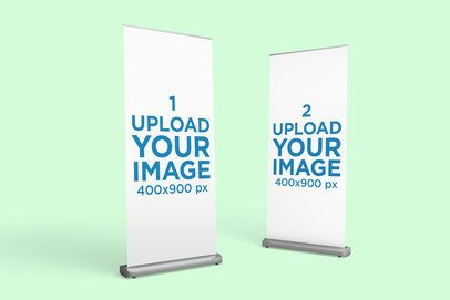 Mockup of Two Roll-Up Banners Standing Against a Solid Color Backdrop 917-el