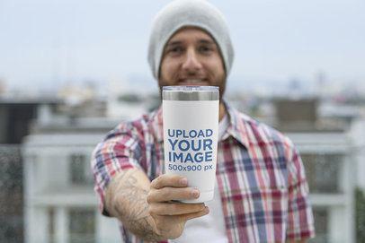 Mockup of a Bearded Man Showing His 20 oz Travel Mug to the Camera 30387