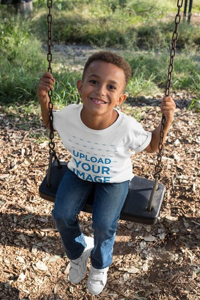 T-Shirt Mockup of a Smiling Boy Playing on a Swing 30605