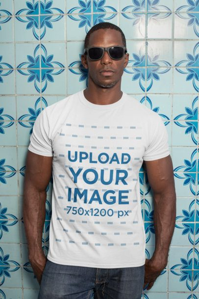 T-Shirt Mockup of a Man with Sunglasses Against a Blue Tiling 30449