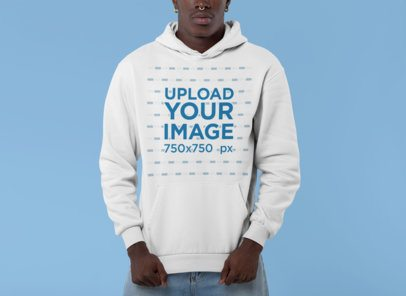 Mockup of a Man in a Studio Showing His Pullover Hoodie 30539