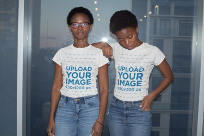 T-Shirt Mockup of a Mom and Daughter Posing Against a Window 30630