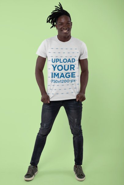 Mockup of a Smiling Man Showing His T-Shirt in a Studio 30543