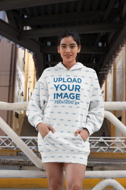 Hoodie Dress Mockup of a Woman Posing Under a Bridge 30523