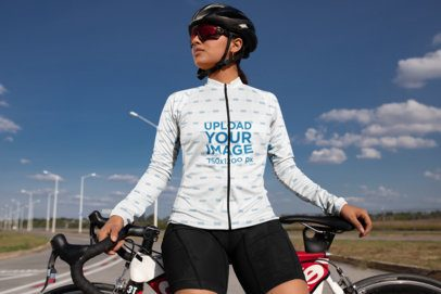 Long Sleeve Cycling Jersey Mockup Featuring a Woman Posing by Her Bike 30782