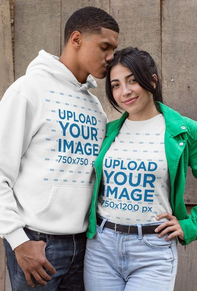 Mockup of a Man with a Hoodie Kissing a Woman Wearing a T-Shirt 30534