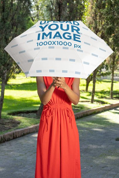 Mockup Featuring a Woman Holding a Sublimated Umbrella at a Park 30734