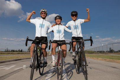 Mockup of Three Friends Wearing Cycling Jerseys and Celebrating 30789