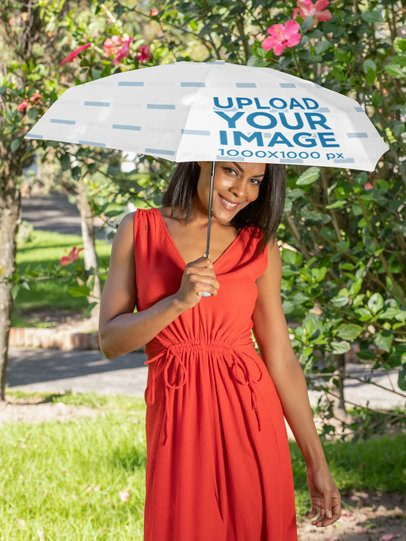Umbrella Mockup Featuring a Smiling Woman by a Flower Plant 30731