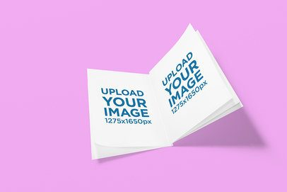 Mockup of an Open Booklet Placed on a Customizable Background 1309-el