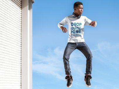 Long Sleeve T-Shirt Mockup of a Young Man Jumping Mid-Air a8815