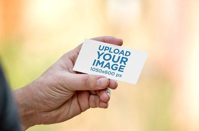 Mockup of a Man's Hand Holding a Business Card 1648-el