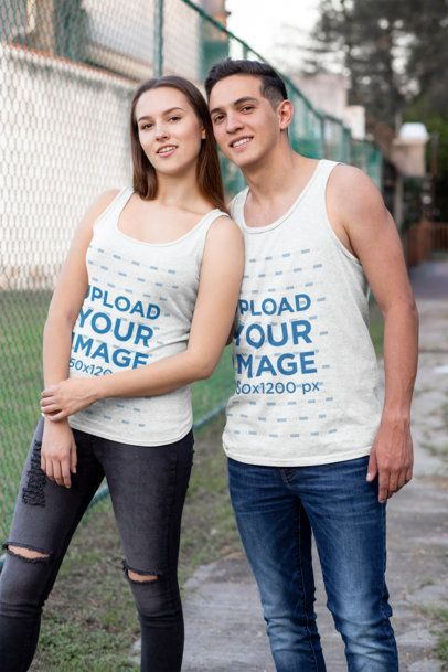 Heather Tank Top Mockup Featuring a Couple Posing at the Park 30753