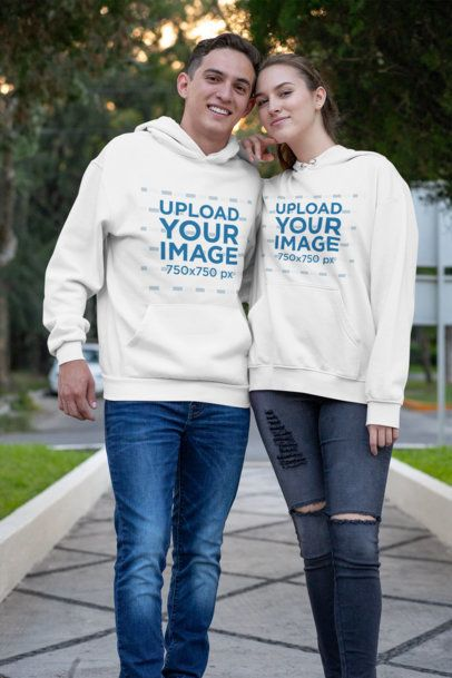 Pullover Hoodie Mockup of a Happy Couple at a Park 30755