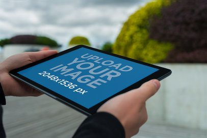 Mockup of a Man Holding an iPad in Landscape Position 2054-el1
