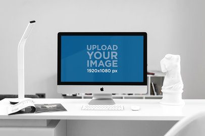 Mockup of an iMac Placed on a White Desk 2142-el