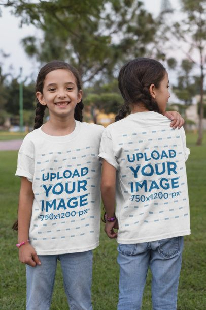 Front and Back View Mockup of Twin Girls Wearing T-Shirts at a Park 30710