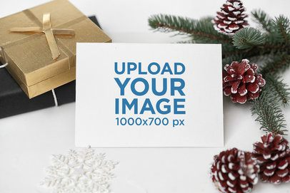 Mockup of a Postcard Surrounded by Christmas Decorations 2085-el1