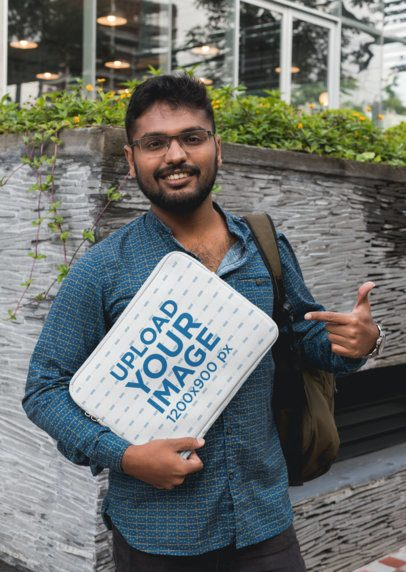 Mockup of a Man Pointing at a Laptop Sleeve 30866