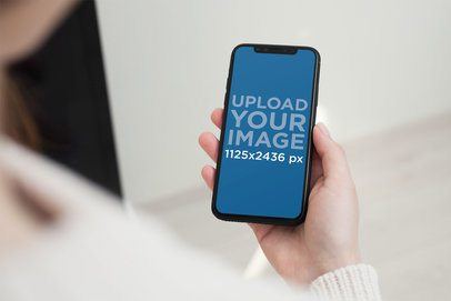 Mockup of a Woman Holding an iPhone 11 Pro in Portrait Position 2161-el1