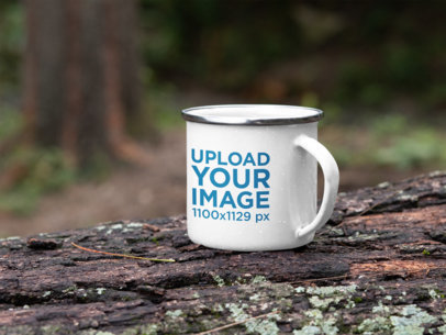 Mockup of a Silver Rim Enamel Mug Placed on a Log in the Woods 30819a