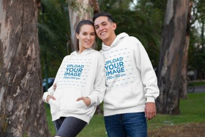 Mockup of a Smiling Couple wearing Matching Hoodies at the Park 30754