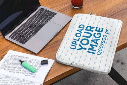Mockup of a Laptop Sleeve Placed over a Working Desk 30871