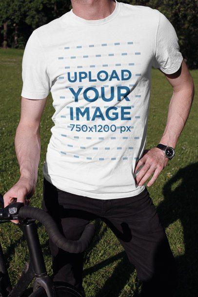 T-Shirt Mockup of a Man Posing with His Bicycle 2017-el1