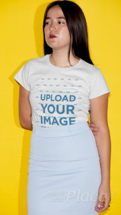 T-Shirt Video Featuring a Serious Woman Posing in Front of a Bright Wall 22735