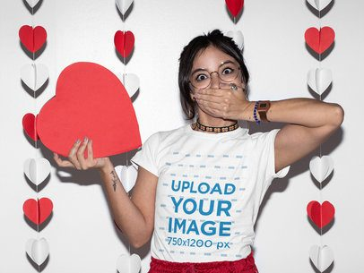 T-Shirt Mockup of a Surprised Woman Surrounded by Heart Decorations 31240