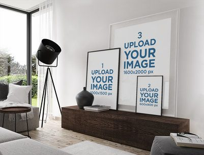 Mockup Featuring Three Art Prints Placed Against a Modern Living Room Wall 1966-el1